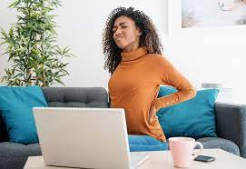 Women in back pain from remote working